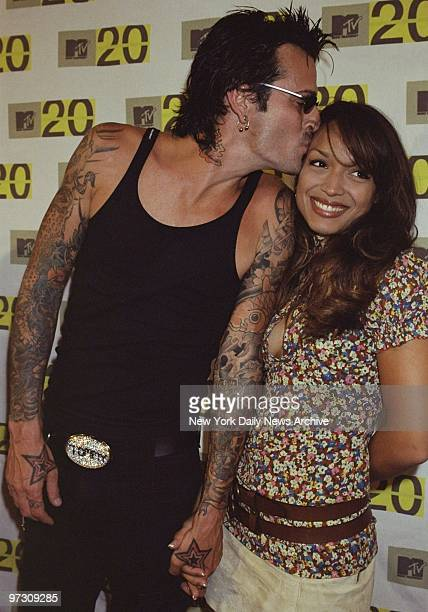 Tommy Lee of Motley Crue plants a smooch on girlfriend Mayte Garcia on their arrival at Hammerstein Ballroom to celebrate the 20th anniversary of MTV