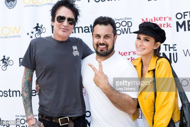Tommy Lee Off the Menu Founder CEO Lawrence Longo and Tommy Lee's Fiance Brittany Furlan attend the Los Angeles Times Food Bowl Secret Burger...