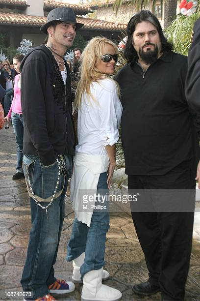 Tommy Lee, Pam Anderson and John Paul DeJoria II during Snowy Christmas Eve in Malibu - December 24, 2005 at Private Residence in Malibu, CA, United...