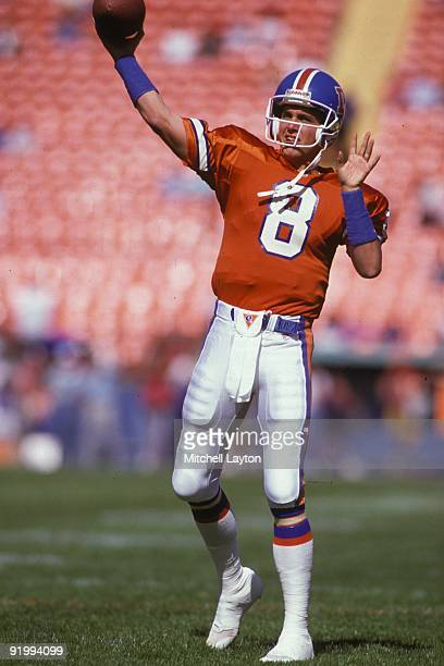 Tommy Maddox of the Denver Broncos warms up before an NFL football game against the Kansas City Chiefs on October 4, 1992 at Mile High Stadium in...