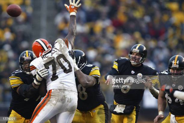 Tommy Maddox of the Pittsburgh Steelers eyes his pass as Alvin McKinley of the Cleveland Browns tries to knock it down while being blocked by Marvel...