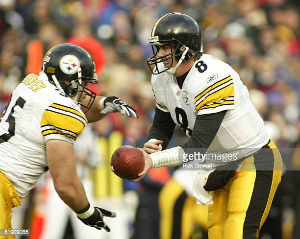Tommy Maddox of the Pittsburgh Steelers hands off to Dan Krieder against the Buffalo Bills January 2, 2004 at Ralph Wilson Stadium in Orchard Park,...