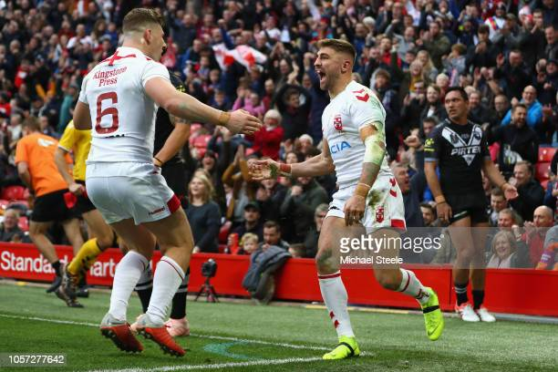 Tommy Makinson of England celebrates scoring his sides first try alongside George Williams during the 2nd International Series match between England...