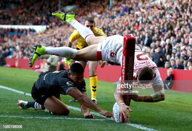 Tommy Makinson of England scores a try while being challenged by Jamayne Isaako of New Zealand but it is later disallowed during the International...