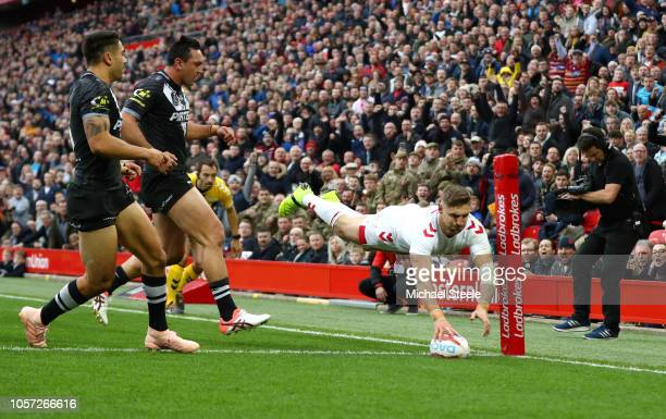 Tommy Makinson of England touches down to score a try during the International Series second test match between England and New Zealand at Anfield on...