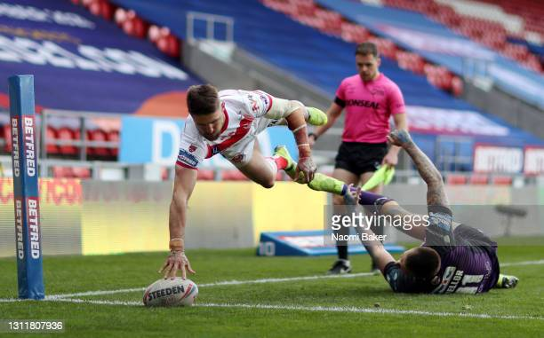 Tommy Makinson of St Helens scores a try during the Betfred Challenge Cup match between St Helens and Leeds Rhinos at Totally Wicked Stadium on April...