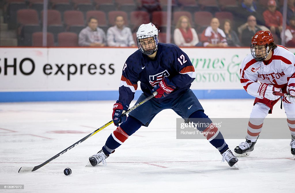 Tommy Miller #12 of the U.S. National Under-18 Team controls the puck during NCAA exhibition hockey against the Boston University Terriers at Agganis Arena on October 6, 2016 in Boston, Massachusetts. The Terriers won 8-2.