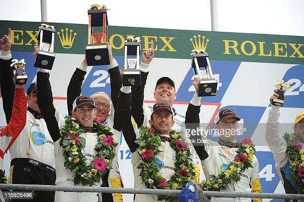 Tommy Milner of the United States Olivier Beretta of Monaco and Antonio Garcia of Spain drivers of the Corvette Racing C6 ZR celebrate victory in the...