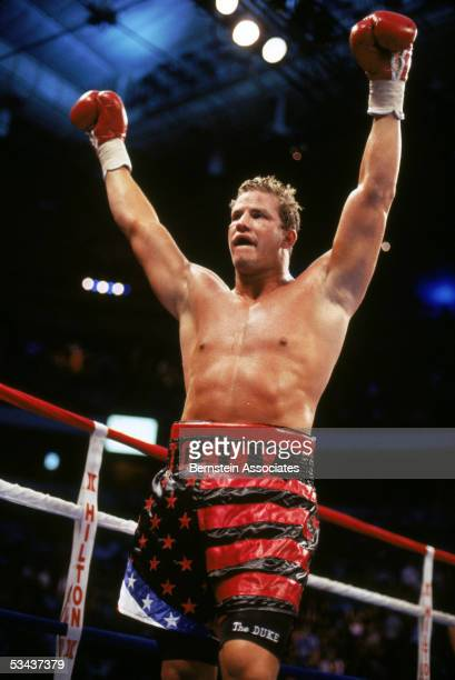 Tommy Morrison celebrates at the end of a twelve rounds boxing bout with George Foreman for the Vacant WBO Heavyweight Title at Thomas Mack Center on...
