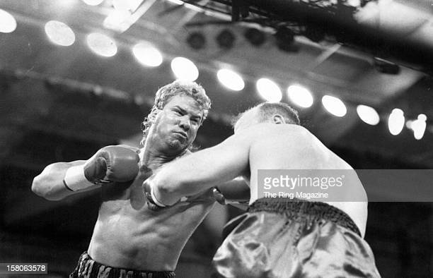 Tommy Morrison lands a left punch against Jerry Halstead during the fight at Caesars Palaceon March 201992 in Las Vegas Nevada Tommy Morrison won by...