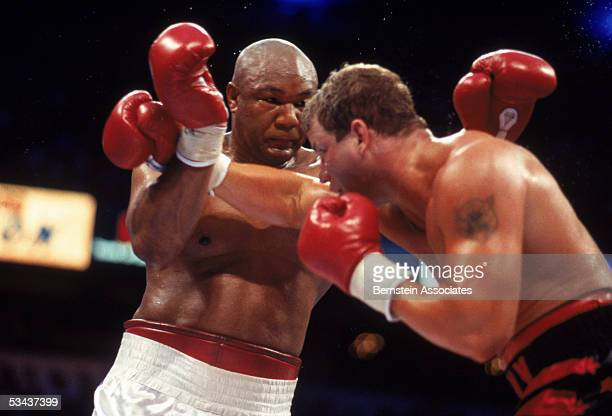 Tommy Morrison swings at George Foreman during their twelve rounds boxing bout for the Vacant WBO Heavyweight Title at Thomas Mack Center on June 7...