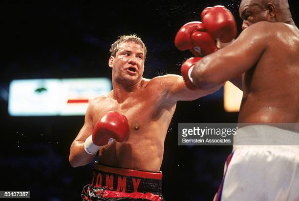 Tommy Morrison throws a left jab at George Foreman during their twelve rounds boxing bout for the Vacant WBO Heavyweight Title at Thomas Mack Center...