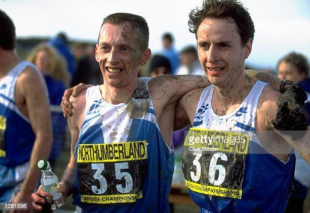 Tommy Murray of Scotland puts his arm around another competitor after an event during the UK Cross Country Championships at Druridge Bay Park in...
