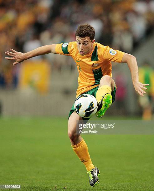 Tommy Oar of Australia controls the ball during the FIFA World Cup qualifier match between Japan and Australia at Saitama Stadium on June 4 2013 in...