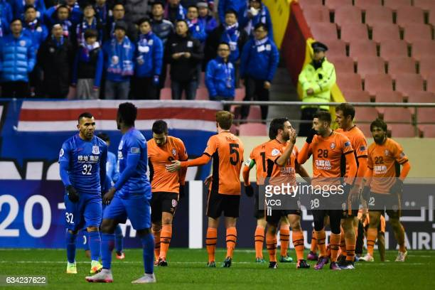 Tommy Oar of Brisbane Roar celebrates with team mates after scoring his team's second goal during the AFC Champions League 2017 playoff match between...