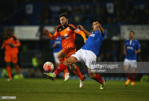 Tommy Oar of Ipswich Town and Gary Roberts of Portsmouth compete for the ball during the Emirates FA Cup Third Round Replay match between Portsmouth...