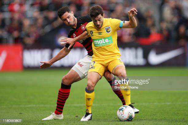 Tommy Oar of the Mariners competes with Dylan McGowan of the Wanderers during the round one ALeague match between the Western Sydney Wanderers and...