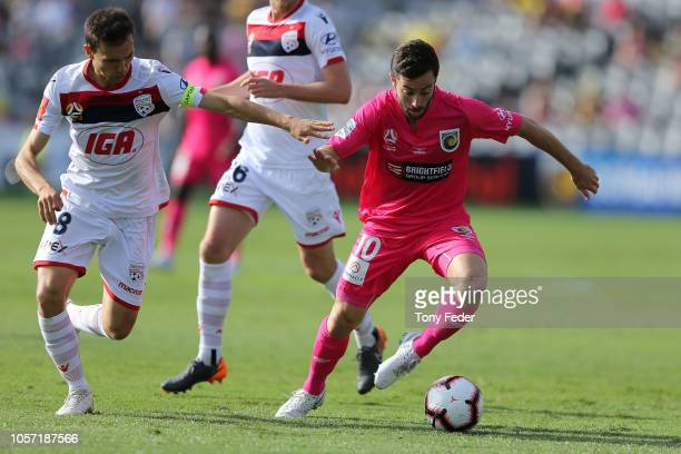 Tommy Oar of the Mariners contests the ball with Isaias of Adelaide during the round three A-League match between the Central Coast Mariners and...