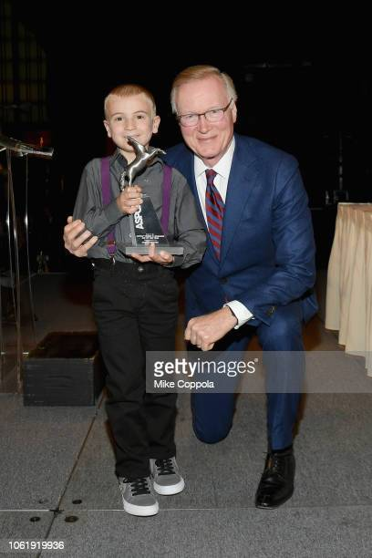 Tommy P Monahan Kid of Year Award Honoree Roman McConn and Chuck Scarborough attend the ASPCA Hosts 2018 Humane Awards Luncheon at Cipriani 42nd...