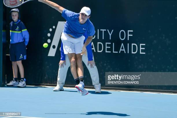 Tommy Paul of the US hits a return to Aljaz Bedene of Slovenia during their men's first round singles match at the Adelaide International tennis...