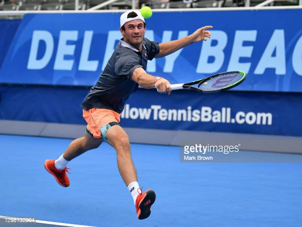 Tommy Paul returns a shot to Ariel Behar of Uruguay and Gonzalo Escobar of Ecuador while playing with Mackenize McDonald during the Doubles...