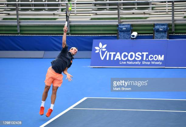 Tommy Paul serves to Ariel Behar of Uruguay and Gonzalo Escobar of Ecuador while playing with Mackenize McDonald during the Doubles Semifinals of the...