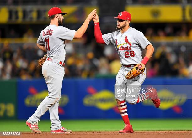 Tommy Pham celebrates with Paul DeJong of the St Louis Cardinals after a 1110 win over the Pittsburgh Pirates at PNC Park on August 18 2017 in...