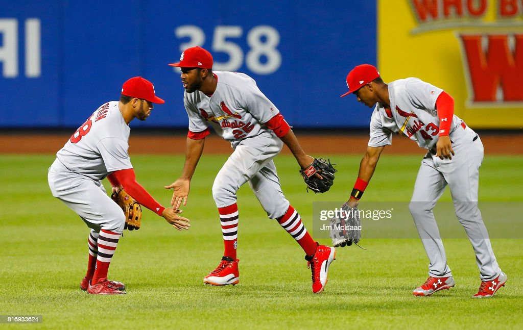 Tommy Pham #28, Dexter Fowler #25 and Magneuris Sierra #43 of the St. Louis Cardinals celebrate after defeating the New York Mets on July 17, 2017 at Citi Field in the Flushing neighborhood of the Queens borough of New York City.