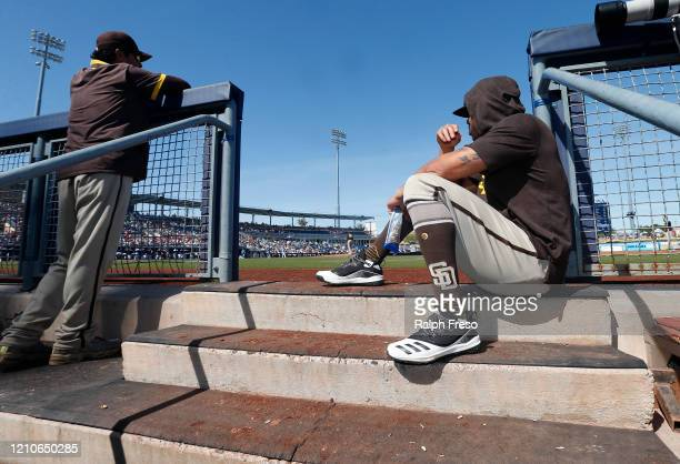 Tommy Pham of the San Diego Padres watches from the steps of the dugout during the third inning of a Cactus League spring training baseball game...
