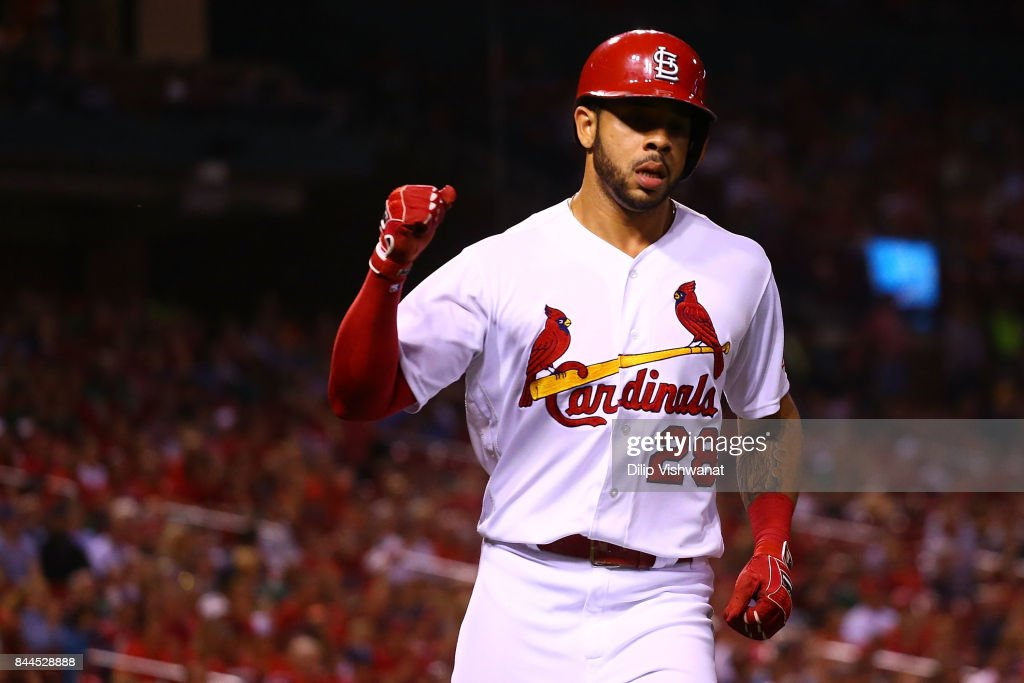 Tommy Pham #28 of the St. Louis Cardinals celebrate after scoring a run against the Pittsburgh Pirates in the fourth inning at Busch Stadium on September 8, 2017 in St. Louis, Missouri.
