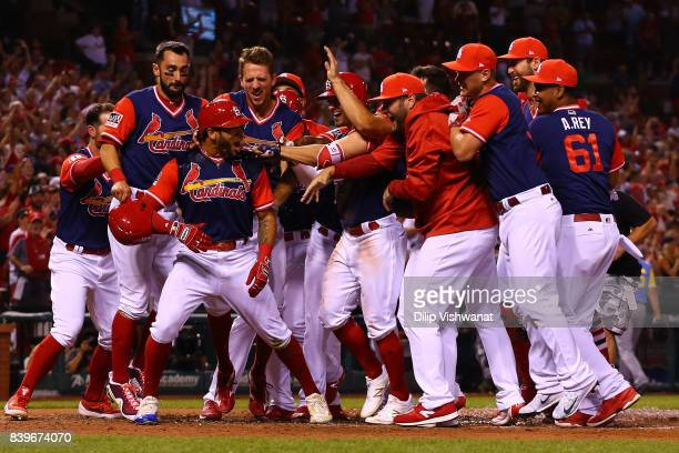 Tommy Pham of the St Louis Cardinals celebrates with his teammates after hitting a tworun walkoff home run against the Tampa Bay Rays in the ninth...