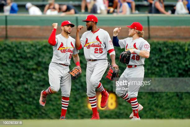Tommy Pham of the St Louis Cardinals Dexter Fowler and Harrison Bader celebrate their win over the Chicago Cubs at Wrigley Field on July 20 2018 in...