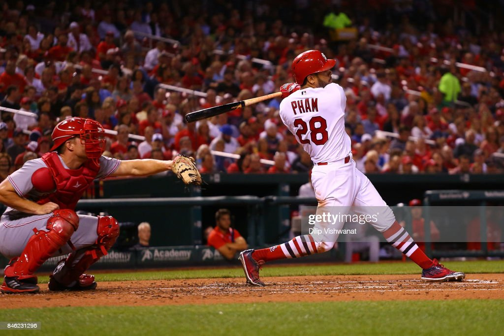 Tommy Pham #28 of the St. Louis Cardinals drives in two runs with a triple against the Cincinnati Reds in the second inning at Busch Stadium on September 12, 2017 in St. Louis, Missouri.