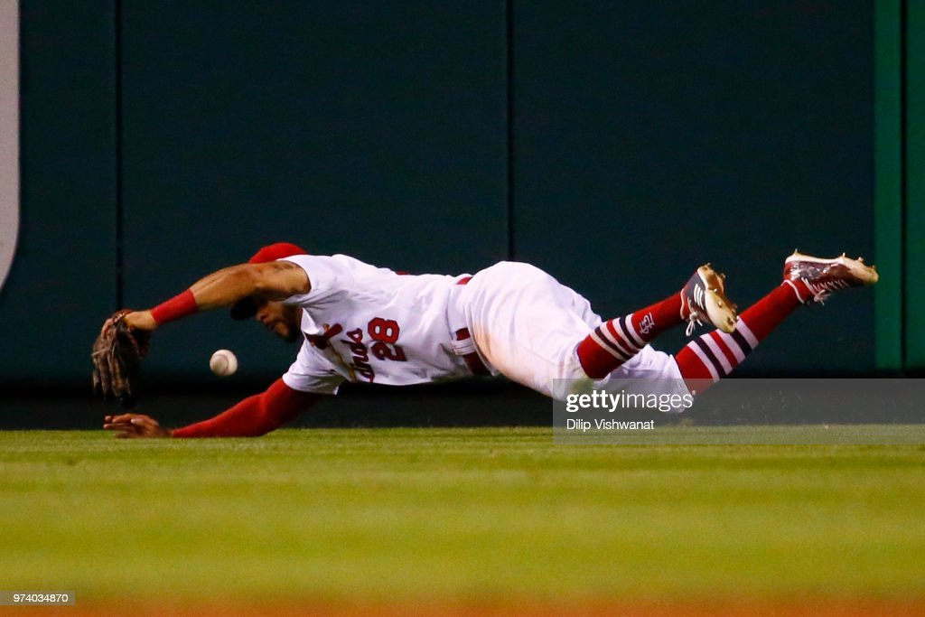 Tommy Pham #28 of the St. Louis Cardinals fails to catch a line drive against the San Diego Padres in the sixth inning at Busch Stadium on June 13, 2018 in St. Louis, Missouri.