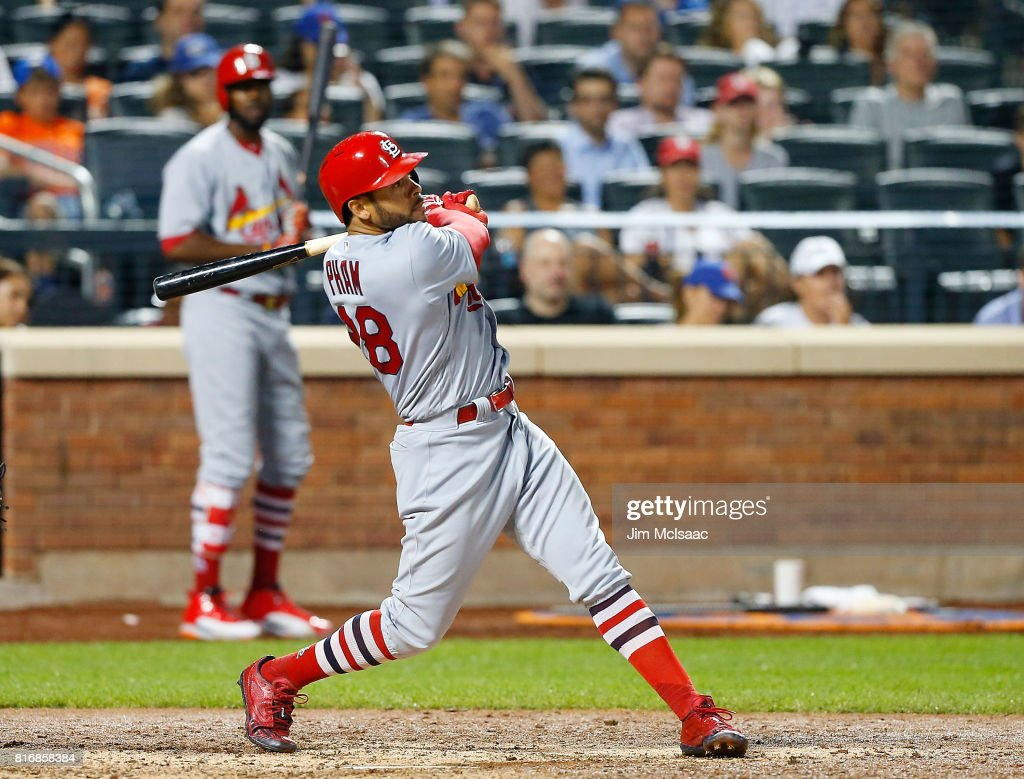 Tommy Pham #28 of the St. Louis Cardinals follows through on a sixth inning three run home run against the New York Mets on July 17, 2017 at Citi Field in the Flushing neighborhood of the Queens borough of New York City.