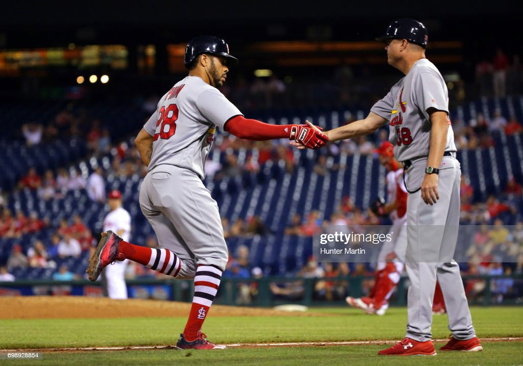 Tommy Pham #28 of the St. Louis Cardinals is congratulated by third base coach Mike Shildt #38 after hitting a two-run home run in the 11th inning during a game against the Philadelphia Phillies at Citizens Bank Park on June 20, 2017 in Philadelphia, Pennsylvania. The Cardinals won 8-1 in 11 innings.