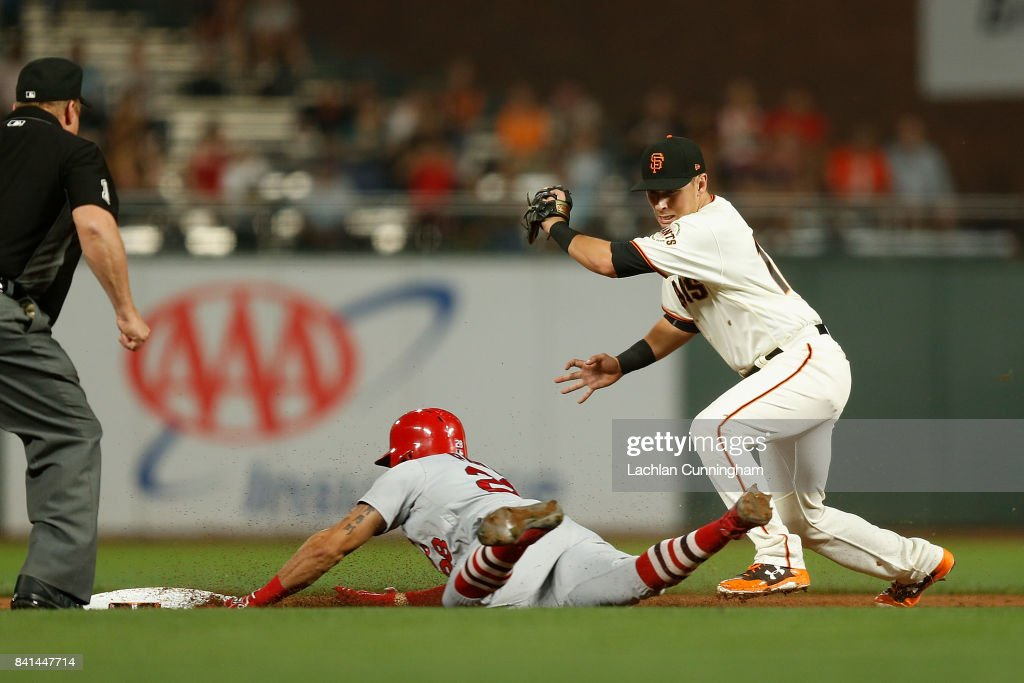 Tommy Pham #28 of the St Louis Cardinals is safe at second base as Joe Panik #12 of the San Francisco Giants attempts to get the out in the third inning at AT&T Park on August 31, 2017 in San Francisco, California.