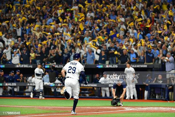 Tommy Pham of the Tampa Bay Rays rounds the bases after his home run against the Houston Astros during the first inning in game four of the American...
