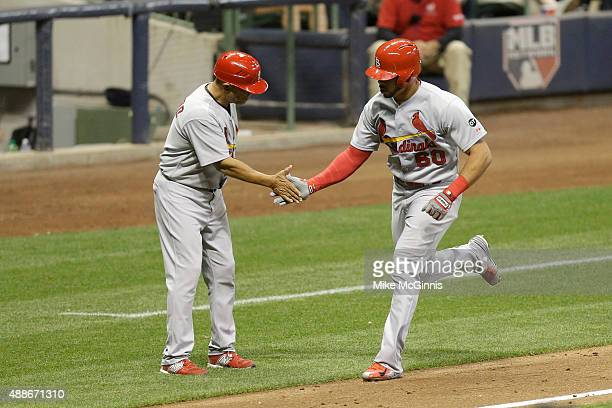 Tommy Phan of the St Louis Cardinals runs the bases after hitting a two run homer in the fourth inning against the Milwaukee Brewers at Miller Park...