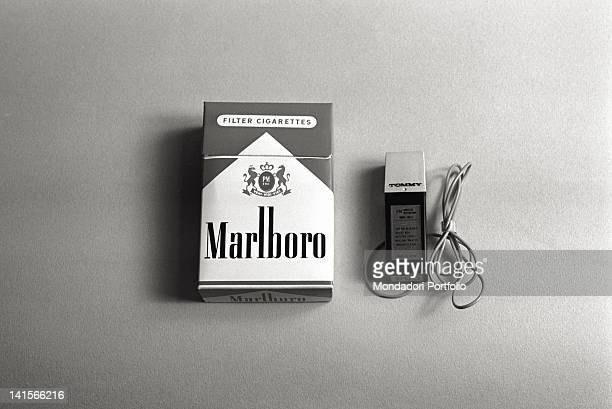 A Tommy radio microphone beside a pack of Marlboro The Japanese bug picks up sounds down to the distance of 40 metres Italy 1960s