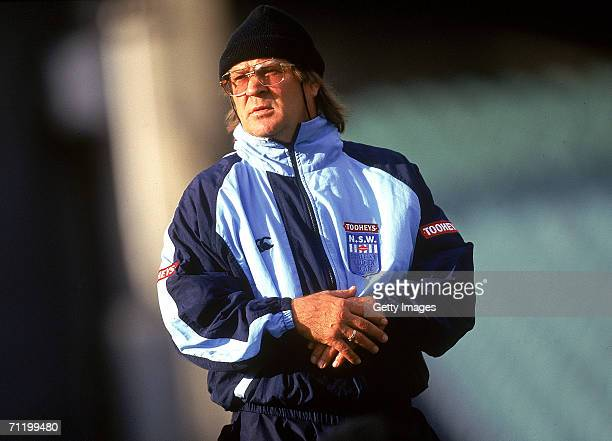 Tommy Raudonikis coach of the New South Wales Blues looks at his players during a training session prior to the 1997 State of Origin match between...