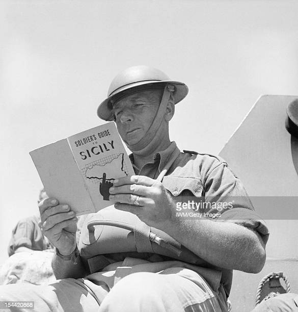 The Campaign In Sicily 1943 Planning and Preparations January July 1943 A 'Tommy' reads the 'Soldiers' guide to Sicily July 1943