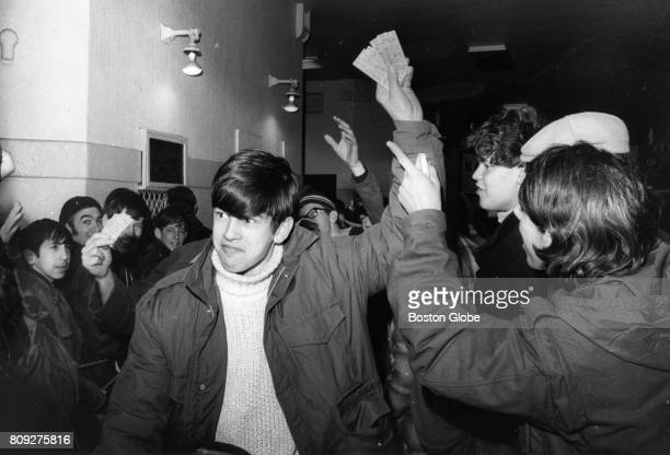Tommy Ready of Medford Mass holds up the four Boston Bruins tickets he purchased after waiting all night at the Boston Garden Jan 18 1971 Ready...