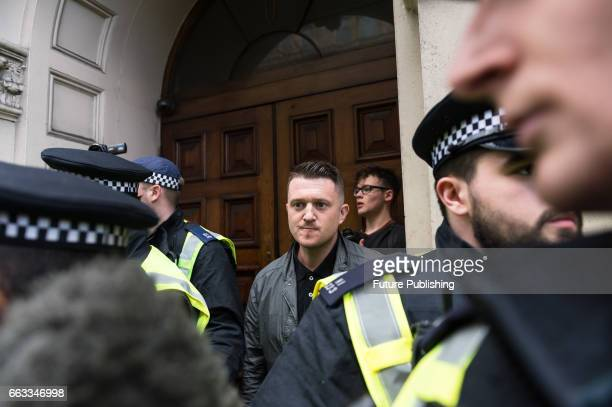 Tommy Robinson former leader of the English Defence League is escorted by the police as supporters of farright and antiIslamic English Defence League...