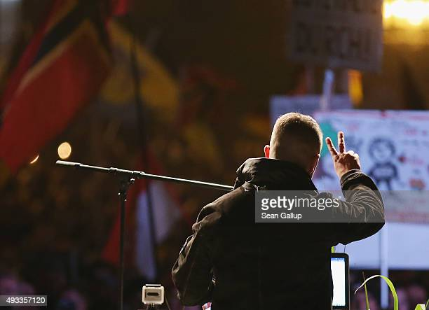 Tommy Robinson of the English Defense League speaks to supporters of the Pegida movement gathered on the first anniversary since the first Pegida...