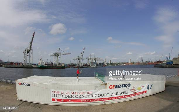 Tommy Robredo of Spain and Philipp Kohlschreiber of Germany play tennis on top of cargo containers in a preview tennis match prior to the ATP Masters...