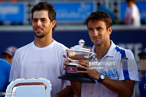 Tommy Robredo of Spain and Santiago Giraldo of Colombia holds the trophy during the ATP Tour on February 6 2011 in Santiago Chile
