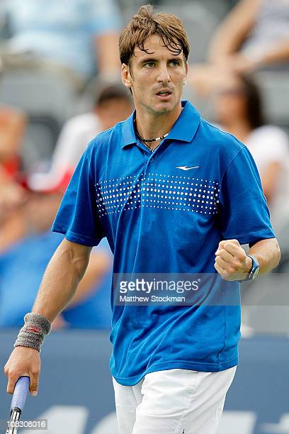 Tommy Robredo of Spain celebrates match point against Jarkko Nieminen of Finland during the Rogers Cup at the Rexall Centre on August 9, 2010 in...
