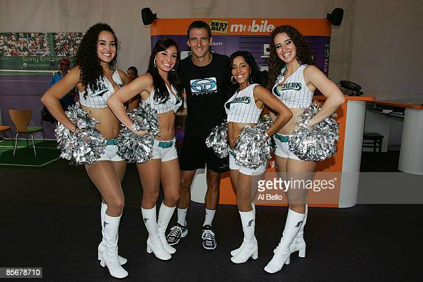 Tommy Robredo of Spain poses with the Florida Marlins Mermaids during day six of the Sony Ericsson Open at the Crandon Park Tennis Center on March 28...