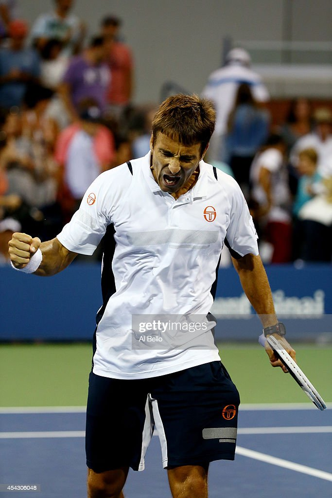 Tommy Robredo of Spain reacts after a point against Simone Bolelli of Italy during their men's singles second round match on Day Four of the 2014 US Open at the USTA Billie Jean King National Tennis Center on August 28, 2014 in the Flushing neighborhood of the Queens borough of New York City.